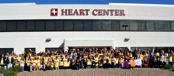 community members in front of heart center